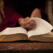 Reading Holy Bible on vintage table — Stock Photo