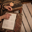 Stock Photo: Reading Holy Bible on vintage table