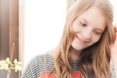 Portrait of young christian blonde girl — Stock Photo
