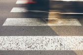 Pedestrian crossing with fast car — Stock Photo