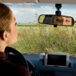 Looking at the rear-view mirror. — Stock Photo