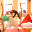 Group in yoga pose(Uthittatriconasana) — Stock Photo