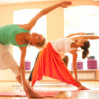 Doing yoga in health club — 图库照片