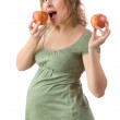 Pregnant woman with apples — Stock Photo #14176168