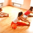 Doing yoga in health club — Stockfoto