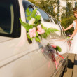 Bride is opening limousine door — Stock Photo