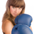 Active young female in blue boxing gloves — Stock Photo #14176253