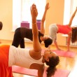 图库照片: Exercising at yogclass