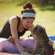 Yoga girl with her dog — Stockfoto