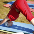 Yoga practicing outdoors — Foto Stock