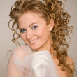 Bride with curly hair — Stock Photo