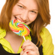 Funny girl bites Lollipop - Stock Photo