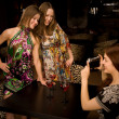 Three young woman in the nightclub — Stock Photo