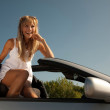 Sitting on the open car — Stockfoto