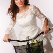 Cycling away bride — Stockfoto