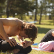 Yoga practicing outdoors — 图库照片