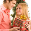 Giving christmas present — Stock Photo