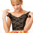 Young woman with sushi — Stock Photo #14176703