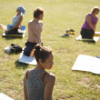 yoga practicing outdoors — Stock Photo #14176776