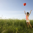 Girl with balloon — Stock Photo