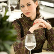 Foto Stock: Young woman at a table