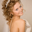 Bride with a hand near her shoulder — Stock Photo