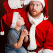 Hard Santas job - Stock Photo