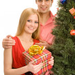 Couple by the christmas tree — Stock Photo