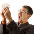Excited businessman with dollars — Stock Photo