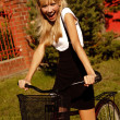 Cheerful girl with bicycle — Stock Photo