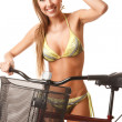Young happy woman on bicycle - Stock Photo