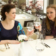 Two young woman  in the restaurant — Stockfoto
