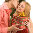 Giving christmas present — Stock Photo #14177023