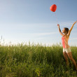 Girl with balloon — Stock Photo #14177081