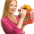Happy girl opening a gift box — Stock Photo
