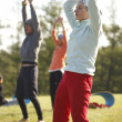 Yoga practicing outdoors - Stockfoto
