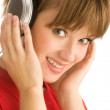Young girl with headphones close-up — Stockfoto