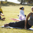 Foto Stock: Yoga practicing outdoors