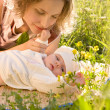 Stockfoto: Mother and baby in grass.
