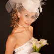 Bride in retro hat - Stock Photo
