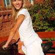 Girl in white with bicycle — Foto de Stock