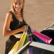 Putting shopping bags in car — Stok fotoğraf