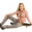 Sitting on skateboard — Stock Photo
