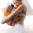 Classical bride with presents — Stock Photo