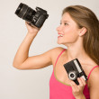 Beautiful girl with digital camera — Stock Photo