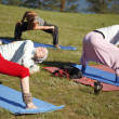 Yoga practicing outdoors — 图库照片 #14177430
