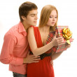 Stock Photo: Couple opening a gift box