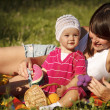 Young woman with her little 1 year old daughter are having fun in the park — Stock Photo #14177447