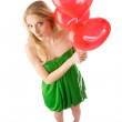 图库照片: Womstanding with three balloons, top view
