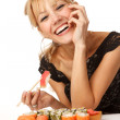 Young woman with sushi — Stock Photo #14177511